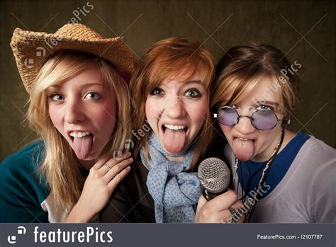 Teenagers: Three Young Girls With Microphone And Tongues